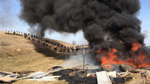 Keepers of the Earth burn pile of tires.jpg